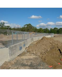 Mesh fence for concrete barrier or jersey barrier